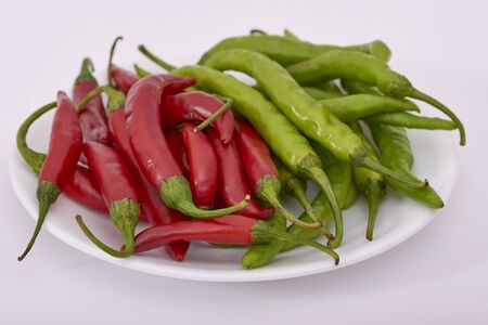 Fresh Red and Green Chillies in a white plate