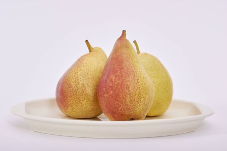 Three Pears in a tray on a white background