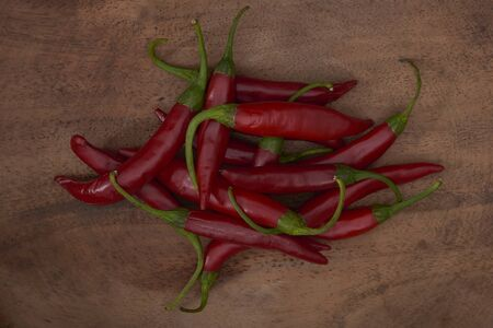 Fresh red chillies arranged on a wooden tray 写真素材