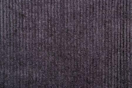 Purple brown corduroy fabric background