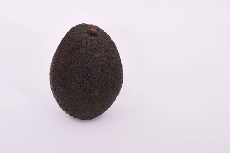 Single ripe brown Hass avocado on a white background 写真素材