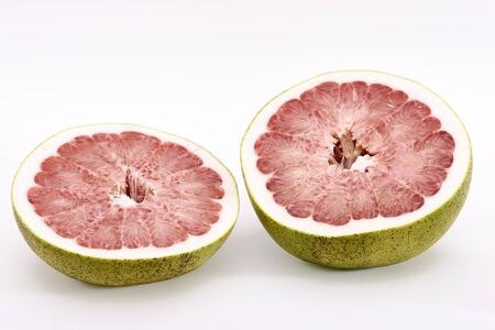 Closeup view of cut pink pomelo on a white background
