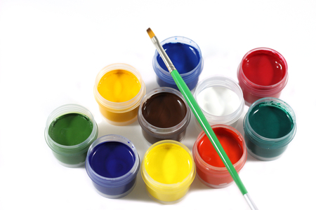 jars with gouache on white background and a rainbow gouache Stock Photo