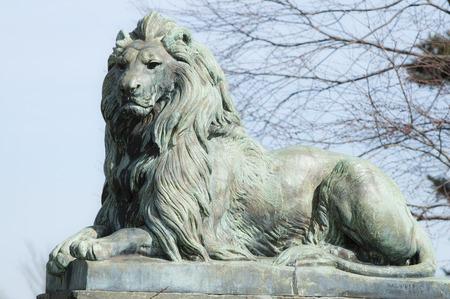 Bronze lion statue graces entrance to Colt State Park