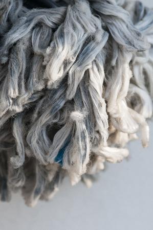 unravel: Fraying line on fishing boat turnng into burst of fiber Stock Photo