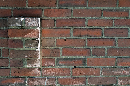 Uneven brick wall showing signs of age Stock fotó