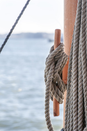 Cleat hitch doing its job aboard a ferry Stock Photo