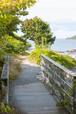 meanders: Scenic walking path meanders along Bar Harbor shoreline Stock Photo