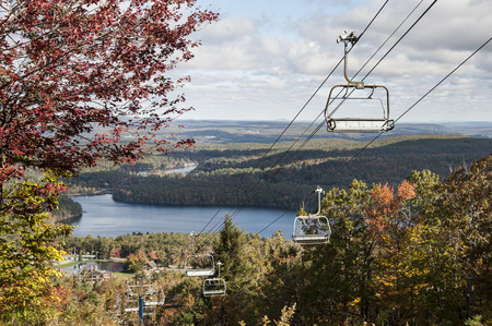 Ski lift cut provides panoramic view of hills and ponds
