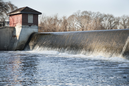 spillway: Water pours over Turner Reservoir spillway in late winter Stock Photo
