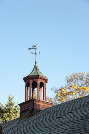 cupola: Aging cupola with weathervane Stock Photo