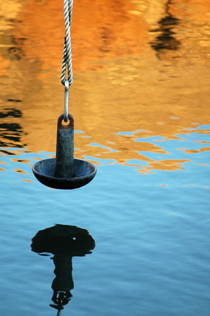 counterweight: Mushroom anchor used as a counterweight at a pier in Mattapoisett, MA Stock Photo