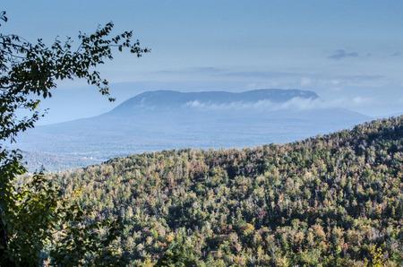 ridgeline: Clouds drift across valley near Baxter State Park