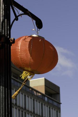 stiff: Chinese red lantern swings in stiff breeze
