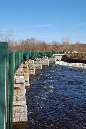 bikeway: Winter rains keep the Blackstone River flowing beneath the bikeway in Lincoln, Rhode Island