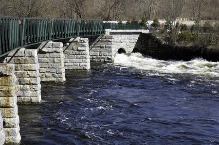 bikeway: Winter rains keep the Blackstone River flowing beneath the bikeway in Lincoln, RI, USA