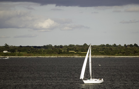Sailboat crossing the Sakonnet River near Sachuest Point