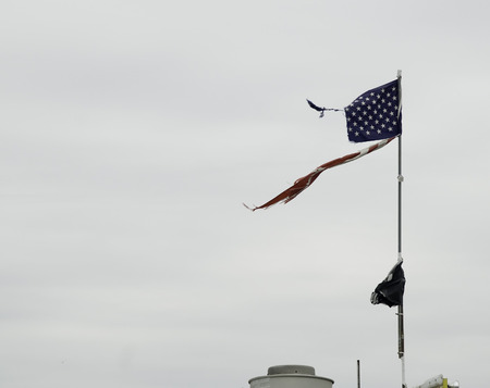 Stiff breeze whips the remains of a  flag at Coney Island