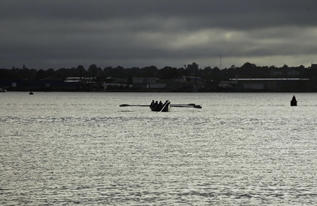 sidelight: Whale boat crew practices under threatening skies