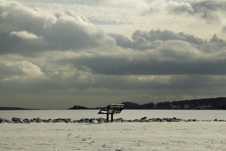 commands: Bench commands view of Narragansett Bay under heavy clouds Stock Photo