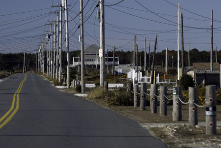 telephone poles: Straight stretch of road with long line of telephone poles