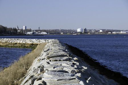 providence: Stone breakwater offers distant view of Providence, Rhode Island