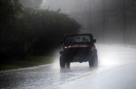 daring: Out for a ride in a summer thunderstorm
