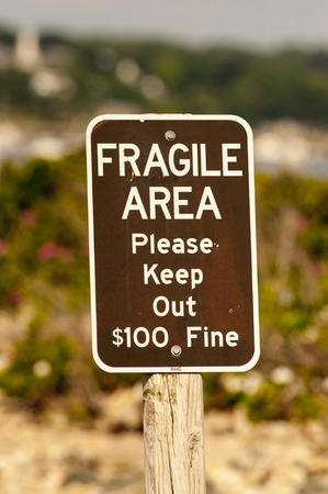 warns: Sign warns of fine for entering a protected area