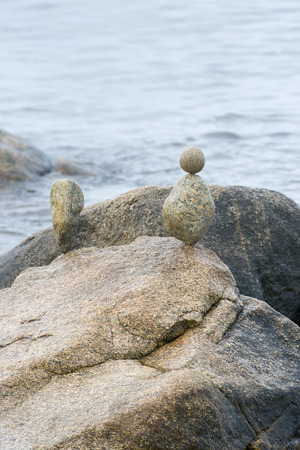 shorelines: Rocks carefully balanced along a rocky shoreline