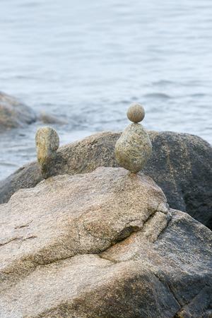 balanced rocks: Rocks carefully balanced along a rocky shoreline