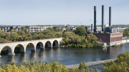 pedestrian bridge: Mississippi River flowing under a pedestrian bridge in Minneapolis Stock Photo