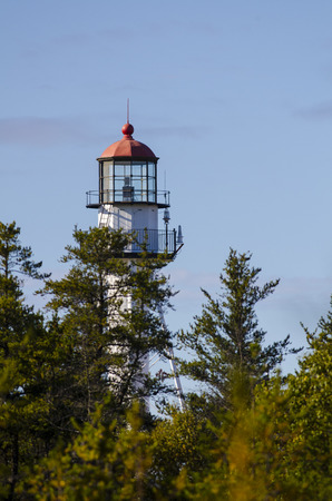 whitefish: Whitefish Point Light Station towers over pines