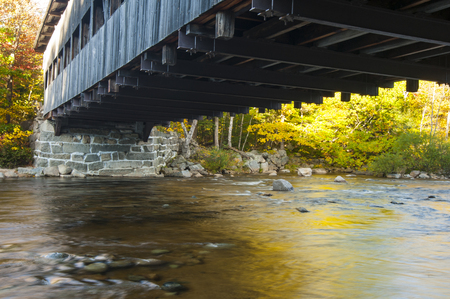 swift: Swift River flowing beneath Albany Covered Bridge in New Hampshire