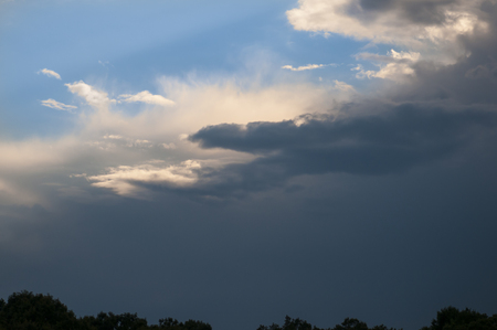 encroaching: Dark storm clouds taking over the sky Stock Photo