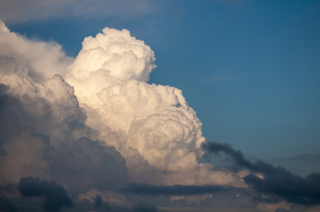 encroaching: Layers of clouds boil across blue sky Stock Photo