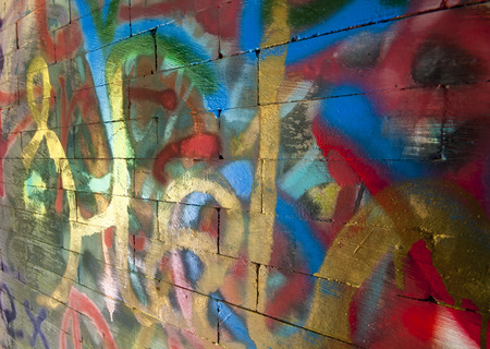 Rough-textured wall with random layers of paint Stock Photo