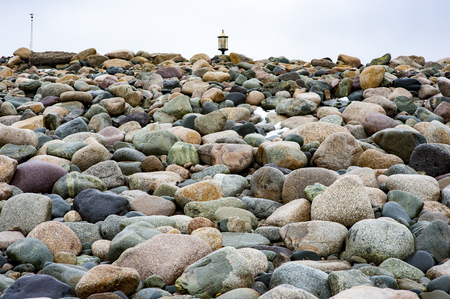 shorelines: Field of rocks driven onto steep beach by storms Stock Photo