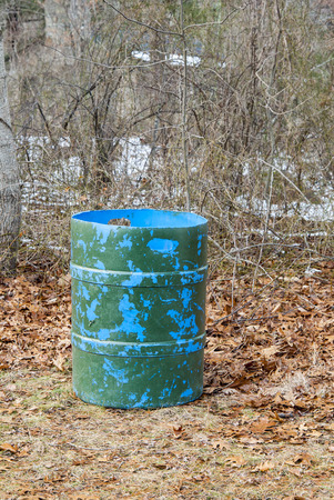 colorfully: Colorfully painted trash container in the woods Stock Photo