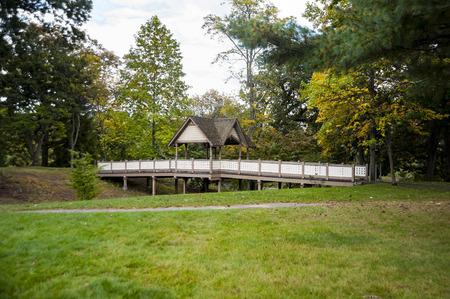 Pedestrian bridge crossing gully in Roger Williams Park in  Providence, Rhode Island Stock Photo