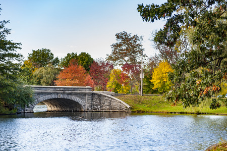 roger: Stone bridge crossing lake in Roger Williams Park in Providence, Rhode Island Stock Photo