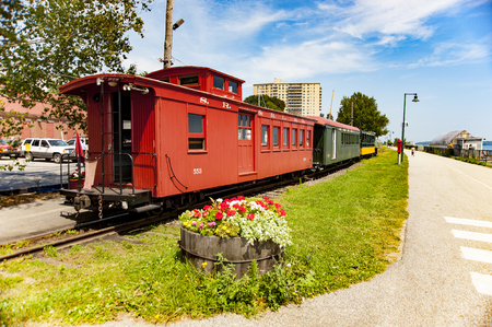 caboose: PORTLAND, MAINE - AUGUST 10, 2009: Working train from Maine Narrow Gauge Railroad Co  Museum lined up along Eastern Promenade Trail on Casco Bay