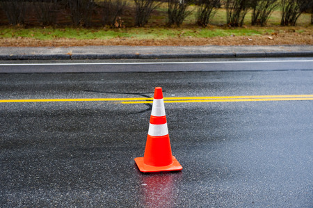 road conditions: Traffic cone warns drivers of unusual road conditions