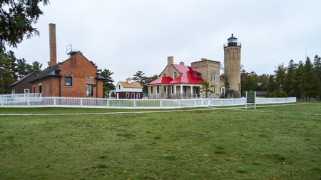 mackinac: Old Mackinac Park Lighthouse in Michilimackinac State Park on a rainy morning Stock Photo