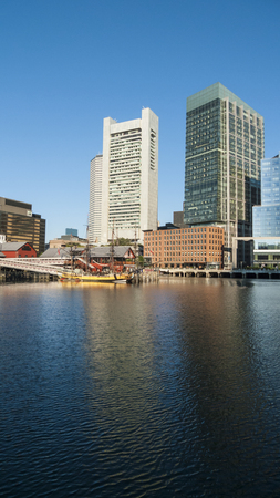 boston tea party: BOSTON, MASSACHUSETTS - AUGUST 27, 2015: Boston Tea Party museum against Boston skyline Editorial