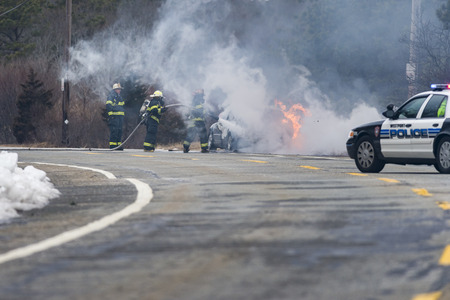 WESTPORT, MASSACHUSETTS - FEBRUARY 20, 2013: Firefighters work to put out car fire near Horseneck Beach in Westport, Massachusetts