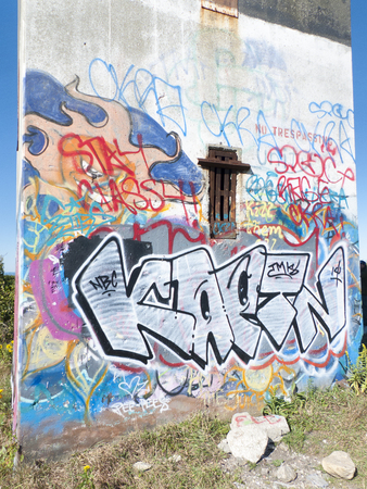 tagging: WESTPORT, MASSACHUSETTS - SEPTEMBER 23, 2014: Latest layer of graffiti on World War Two observation tower