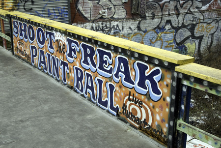 CONEY ISLAND, NEW YORK - DECEMBER 27, 2007: Old sign and grafitti on the old Coney Island boardwalk