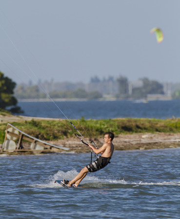 skim: TAMPA BAY, FLORIDA - FEBRUARY 28, 2011: Kiteboarder sets up for next move