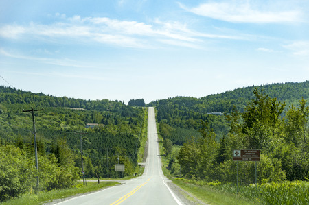 uphill: Big downhill, big uphill on Canadian two-lane road