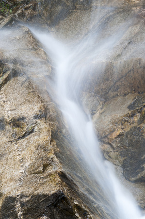 Water pours down rocky Vermont hillside